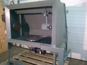 TSD RM2 Spray Booth with headstock, tailstock, turntable, and controller